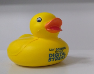 """rubber duck with writing """"say goodbye to your digital stress"""""""